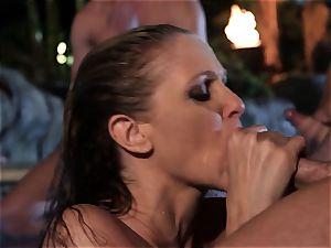 Julia Ann inhales a group of pricks in a pool