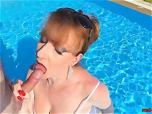 british Mature crimson xxx gargling trouser snake in a pool