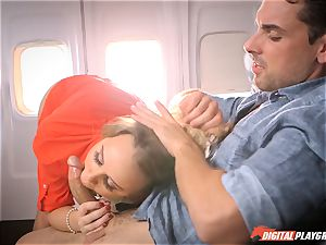 kinky stewardess Alexis Adams drilling with the passengers